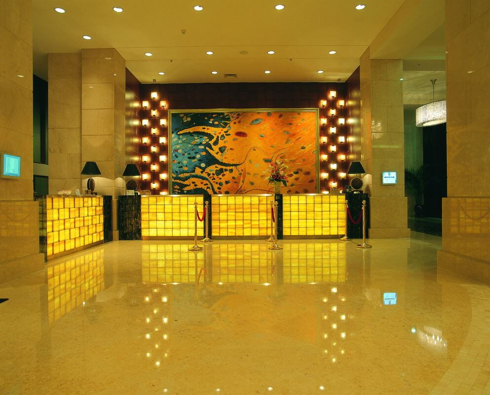 luxury_5_star_hotel_lobby_marble_reception_desk_wooden_metal_frame